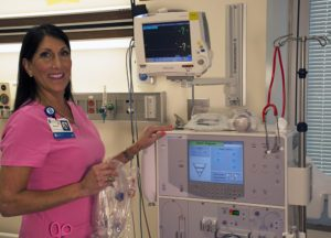 Kirin prepares the dialysis machine for her next patient.